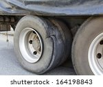 burst tire truck - stock photo