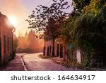 morning old town curvy cobbled street - stock photo