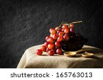 Red grapes on table, still life - stock photo