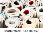 Colorful magazines up close - rolled up composition - stock photo