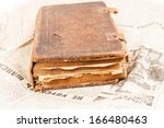 Very old book on newspaper, closeup focus - stock photo