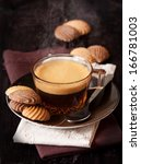 Cup of coffee and chocolate cookies on a linen napkin. - stock photo
