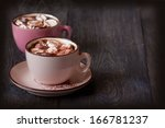 Delicious hot chocolate with marshmallow on wooden background. - stock photo