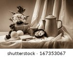 Beautiful still life with vintage basket and flowers - stock photo