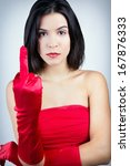 Portrait of Sophisticated and angry woman with red dress - stock photo