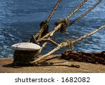 Ship ropes tied at the docks of Antwerp harbor - stock photo