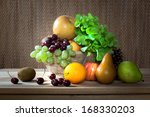 Fresh fruits and vegetable display on wooden table - stock photo