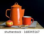 Still life, red tea pot set and apple on table cloths in dark background - stock photo