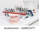 Closeup of a dental tools and plastic jaw - stock photo