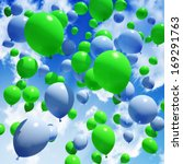 Blue and green Balloon's released into the sky  - stock photo