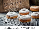 Donuts decorated with powder sugar - stock photo