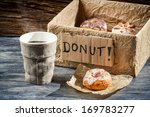 Hot coffee and box full of donuts - stock photo