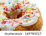 Fresh donut decorated with colored sprinkles - stock photo