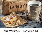 Closeup of donuts with coffee - stock photo