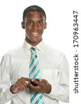 Young businessman texting on a smart phone isolated on a white background - stock photo