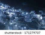 Small village in mountain at night. - stock photo