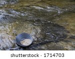 gold panning iin a small stream in northern michigan - stock photo