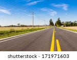 Asphalt country road with horizon - stock photo