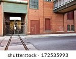 Abandoned World War II factory with train and stop light - stock photo