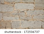 Stone wall texture on an old flour mill - stock photo