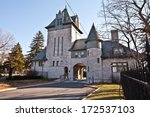Castle at entrance to a cemetery - stock photo