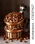 Roasted coffee beans in a metal cups. - stock photo