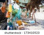 Little kids exploring rustic beach hut - stock photo