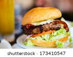 Close up of delicious fresh burger with cheese and bacon - stock photo