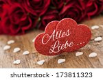 two heart shapes with german text alles Liebe - stock photo