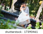 Groom and the bride joy against backdrop fountain. In all growth. - stock photo