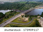 ST PETERSBURG, RUSSIA - JULY 19, 2007: Ring Road crosses river Big Ohta, it is near railway station of Rzhevka, top view, aerial photography. Road bridge over river Big Ohta, construction.  - stock photo