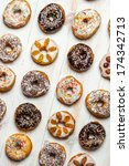 Group of different colorful donuts - stock photo