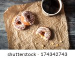 Hot coffee and donuts given in the paper - stock photo