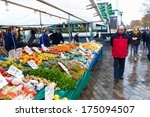 ZWOLLE, THE NETHERLANDS - FEBRUARY 1, 2014: Unidentified man visiting the street market in Zwolle. In the Netherlands there are 18,000 merchants realizing a 2.6 billion turn over. - stock photo