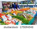 ZWOLLE, THE NETHERLANDS - FEBRUARY 1, 2014: Unidentified merchants selling groceries at the street market in Zwolle. In the Netherlands there are 18,000 merchants realizing a 2.6 billion turn over. - stock photo