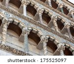 Architectural Arch Details on the Side of the Cathedral of Lucca - stock photo