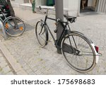 Bicycle parked on pavement in Brussel, Belgium  - stock photo