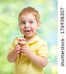 Boy eating ice cream - stock photo