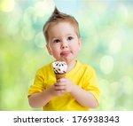 Boy eating icecream - stock photo