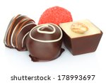 Assorted chocolate candies on white background  - stock photo