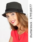 petty girl in black hat and with big smile - stock photo