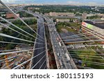St-Petersburg, Russia -  August 31, 2007: View from the pylon cable-stayed bridge at road junctions, motor transportation streams, and the city in northern Europe, summer, daytime.  - stock photo