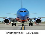 Commercial airplane pulling at the gate - stock photo