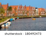 Street with New Modern Houses in an Urban Area in the Netherlands - stock photo