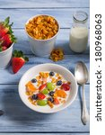 Corn flakes with fruit and milk - stock photo