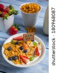 Enjoy your breakfast with cornflakes and fruits - stock photo