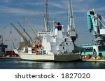 Cargo ship being unloaded at Antwerp harbor (all brand names and logos have been removed) - stock photo