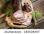 Freshly smoked ham in a rural smokehouse - stock photo