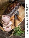 Freshly sliced �¢??�¢??smoked ham and marjoram - stock photo
