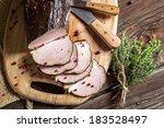 Freshly smoked ham with marjoram - stock photo